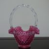 Fenton Cranberry Pink Opalescent Hobnail Glass Basket. High end designer brand used furniture and home decor at significantly low prices. Used Consignment.