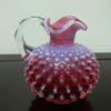Fenton Pink Cranberry Opalescent Hobnail Glass Cruet. High end designer brand used furniture & home decor at significantly low prices.Furniture Consignment.