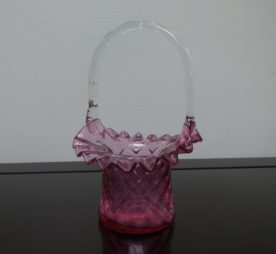 Fenton Pink Cranberry Ruffled Edge Glass Basket. High end designer brand used furniture and home decor at significantly low prices. Furniture Consignment.