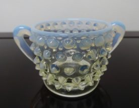 Fenton Opalescent Glass Hobnail Creamer. High end designer brand used furniture and home decor at significantly low prices. Used Furniture Consignment.
