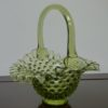 Fenton Art Green Opalescent Hobnail Glass Basket. High end designer brand used furniture and home decor at significantly low prices. Furniture Consignment.