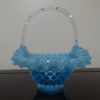 Fenton Art Blue Opalescent Hobnail Glass Basket. High end designer brand used furniture and home decor at significantly low prices. Furniture Consignment.