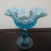 Fenton Art Opalescent Hobnail Blue Vase. High end designer brand used furniture and home decor at significantly low prices. Furniture Consignment.