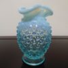Fenton Art Opalescent Hobnail Blue Crimped Vase. High end designer brand used furniture and home decor at significantly low prices. Furniture Consignment.