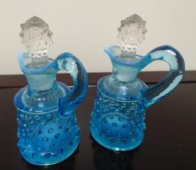 Fenton Art Opalescent Hobnail Blue Cruet. High end designer brand used furniture and home decor at significantly low prices. Furniture Consignment.