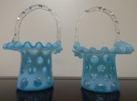2 Fenton Art Opalescent Blue Dot Glass Baskets. High end designer brand used furniture and home decor at significantly low prices. Furniture Consignment.
