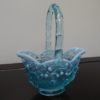 Fenton Art Opalescent Green Glass Basket. High end designer brand used furniture and home decor at significantly low prices. Furniture Consignment.